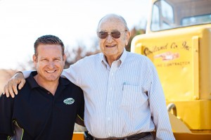 Owners Marv Soiland and his son Mark pose in front of the company's very first tractor.