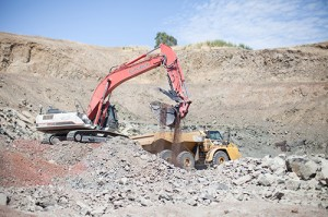 An excavator loads rock at the Stony Point Rock Quarry. The company supplies products for construction and landscape companies, serving wholesale and retail customers for major construction projects and individual home landscaping needs.