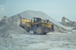 A Komatsu WA500 wheel loader transports materials at the quarry.