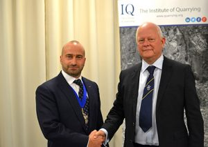Miles Watkins, left, succeeds Anthony Morgan as president of the Institute of Quarrying. Photo courtesy of the Institute of Quarrying