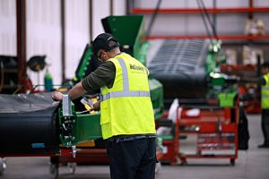 A worker assembles a McCloskey wash plant. Photo courtesy of McCloskey International