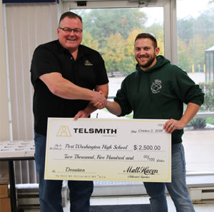 Brian Taylor, left, Director of Manufacturing for Telsmith, presents the donation to Taylor Last, right, Port Washington High School Technology Education and FIRST Robotics Team coach. Photo courtesy of Telsmith