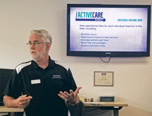 Jim Bretz, director of uptime and connected services at Volvo CE, dives into ActiveCare Direct during this fall's trade press event. Photo: Kevin Yanik