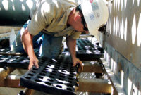 A worker handles modular synthetic media in a middle deck. Photo courtesy of Polydeck