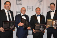 The 2019 Pit & Quarry Hall of Fame class. Pictured left to right: Tommy Fisher, who accepted on behalf of his father, Fisher Industries' Gene Fisher; Polydeck's Manfred Freissle; McLanahan Corp.'s George Sidney; and Niklas Haver, who accepted on behalf of W.S. Tyler/Haver & Boecker's Washington Samuel Tyler. Photo by Allison Barwacz