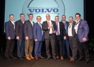 Alta Equipment representatives join Volvo CE reps to celebrate their successful partnership. From left are Evan Perry, district director, Volvo CE; Scott Sebastian, director of marketing, CE Group (Alta Equipment); Bruce Davis, director of sales, CE Group Michigan; Agako Nouch, VP sales North America, Volvo CE; Ryan Greenawalt, CEO, Alta Equipment; Stephen Roy, president of sales region Americas, Volvo CE; Aaron Dorgan, VP rental, CE Group; Mike Dahlen, regional VP Illinois, CE Group; Rob Chiles, president CE Group. Photo courtesy of Volvo CE