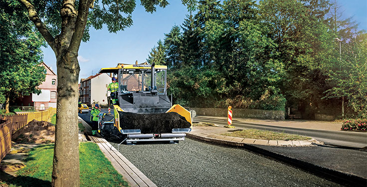 Recycled plastic, seen here being added to asphalt mix, could pave the way into the future. Photo courtesy of Volvo CE