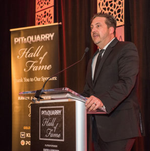 Tommy Fisher, the president and CEO of Fisher Sand & Gravel who's pictured at the 2019 Pit & Quarry Hall of Fame Induction Ceremony, is confident his company can handle President Trump's border wall project more efficiently. Photo by PamElla Lee Photography