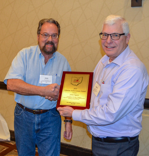 John Capers, right, served on the NFPA (National Fire Protection Association) 495 and 498 Committee on Explosives and as a technical advisor and reviewer for many publications and programs. Photo courtesy of Austin Powder