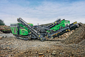 The track-and-crush feature on EvoQuip's Cobra 290R is standard, providing operators the ability to move the machine using the optional remote control from the excavator cab without shutting down the crusher. Photo courtesy of EvoQuip.