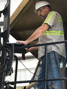 David Copley, a Haydon Materials mechanic, regularly puts Caterpillar's ET (Electronic Technician) program to use to identify critical problems with equipment. Photo: Kevin Yanik