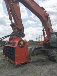 The ALLU transformer M 3-20 material processing excavator attachment on EP Minerals' Hitachi 650 excavator. Photo courtesy of ALLU.