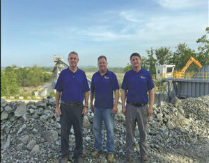 While Kevin Holloway (left) and his brother Brian Holloway (center) remain active in the aggregate operation, Jesse Holloway represents the next generation of the family company. Photo by Kevin Yanik .