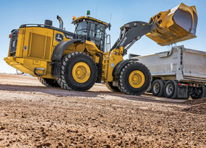 John Deere's new line of wheel loaders include cabs that offer premium radio, a backup camera, automatic temperature control and power-adjusted exterior mirrors. Photo courtesy of John Deere