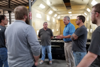 """Says John Lamprinakos: """"I'm not the expert of the best practices here, the people doing the work every day are. I intend to spend a great deal of time with them, as well as our sales team and our dealers, to learn all I can as we build a path toward our future success, and crush every job."""" Photo courtesy of Screen Machine"""