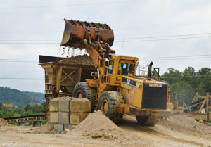 A 988F wheel loader feeds the 42-in. jaw crusher at Magruder Limestone. Production manager Clark Bollinger prefers to keep the loader within 500 ft. of the face at all times. Photo by Kevin Yanik