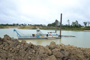 This dredge, which was purchased new from DSC Dredge ahead of opening the Rye Plant, pumps about 400 to 500 tph of material through a 14-in. pipeline. The material is pumped to the plant in the far background. Photo by Joe McCarthy