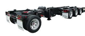 Talbert Manufacturing offers the 65SA Modular Trailer with a design that features a flip extension to accommodate a tandem- or tri-axle jeep dolly, allowing for maximum load configurations. It can also pair with Talbert's revolutionary E2 or E3Nitro axle extension, which dampens axle movement and controls load transfer. Photo courtesy of Talbert Manufacturing