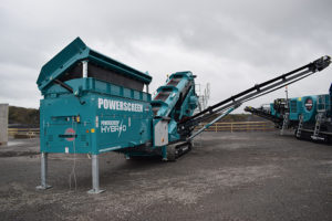 The Powerscreen Chieftain 1700X Hybrid screen is available with a hydraulically folding extended auxiliary conveyor, complete with a transfer conveyor that allows for easy recirculation with the entire range of Powerscreen crushing machines. Photo courtesy of Powerscreen