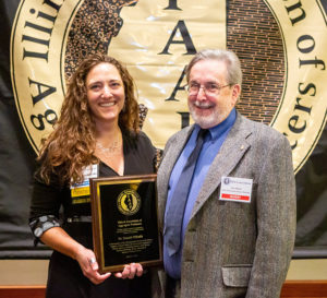 LafargeHolcim's Becky Kazmierski, left, presents a plaque to Donald Mikulic during the IAAP Annual Convention. Kazmierski serves IAAP as chairperson of its Public Information & Education Committee. Photo: IAAP