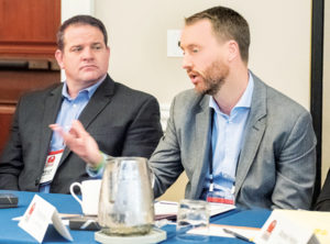 Turner Mining Group's Thomas Haun, right, weighed in on capital expenditure trends during a roundtable discussion. Kelly Graves of Wirtgen America is seated next to Haun. Photo: PamElla Lee Photography