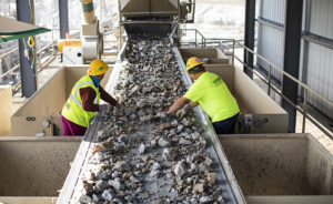 Associates at the Luck Stone Atlanta-Stephens Plant pick deleterious materials, such as wood, asphalt and plastic, from a conveyor belt. Photo: Luck Companies