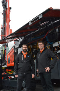 Sandvik Mining & Rock Technology's Hughes Daoust, left, and Hugues Charbonneau pose in front of the new Leopard DI650i DTH drill rig at ConExpo-Con/Agg 2020. Photo: P&Q Staff