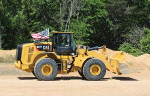 Mississippi-based Hammett Gravel Co. fastened American flags on its fleet of mobile equipment, including this Cat 966M wheel loader. Photo: Hammett Gravel