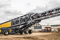 Superior Industries' self-contained, radial telescoping conveyors are equipped with a 96-kW Cat 4.4 Tier 4 Final engine. Photo: Superior Industries