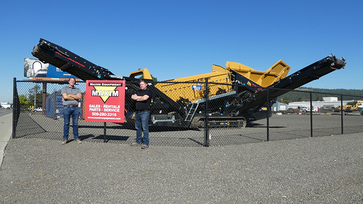 From left: Maxim Equipment sales manager Joe Jensen and general manager Greg Evans are pictured in front of an IRock mobile scalping screen at their new location in Spokane, Washington. Photo: Maxim Equipment