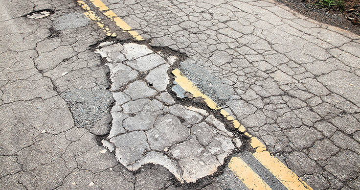 A damaged roadway surface in California. Photo: tupungato/iStock / Getty Images Plus/Getty Images