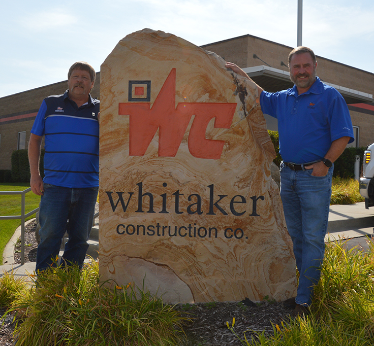 John Sather, left, with Whitaker Construction president and CEO Mike Whitaker. Photo: P&Q Staff