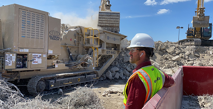 Although some dealer-producer interactions have gone remote, the in-person element is still very much a part of the industry. In this instance, Road Machinery & Supplies territory manager Andrew Lee observes the startup of an Astec GT440 track mounted crushing plant at a jobsite in Des Moines, Iowa. Photo: Road Machinery & Supplies
