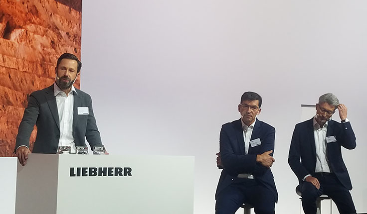 Liebherr hosted a MINExpo press conference Tuesday to discuss concepts such as autonomous operations, remote service support and decarbonization. Pictured here from left are Stephen Albrecht, Jörg Lukowski and Oliver Weiss. Photo: P&Q Staff