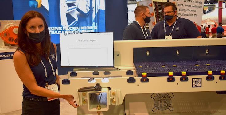Haver & Boecker's Kristen Randall shows off the F-Class vibrating screen at MINExpo International 2021. Photo: P&Q Staff