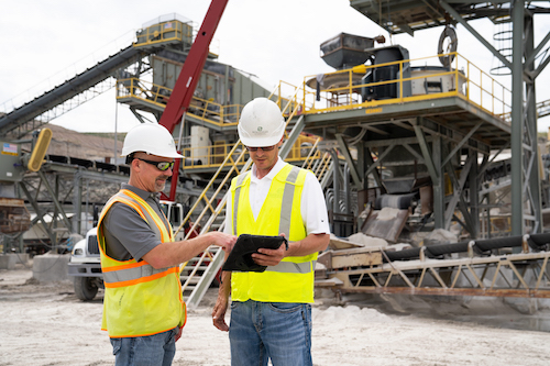 Since installing the Trimble technology, Payne & Dolan's Spencer Johnson says operators have more control over their plants because they can access live scale results on iPads. Photo: Trimble