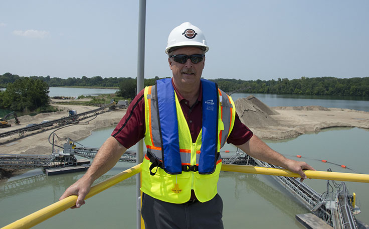 Barrett Paving's Jim Meckstroth says the clamshell dredge is one of the largest capital investments Colas has made in North America. Photo: P&Q Staff